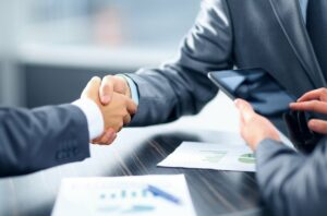 Three people coming to a financial agreement