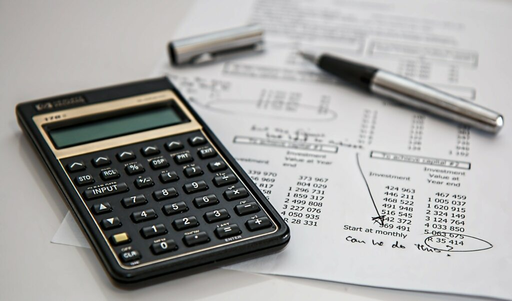 A calculator and a spreadsheet on a table