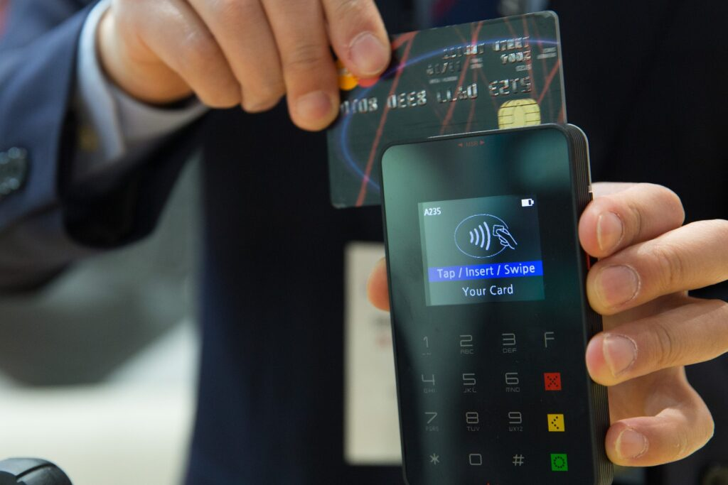 A man making a payment with their credit card