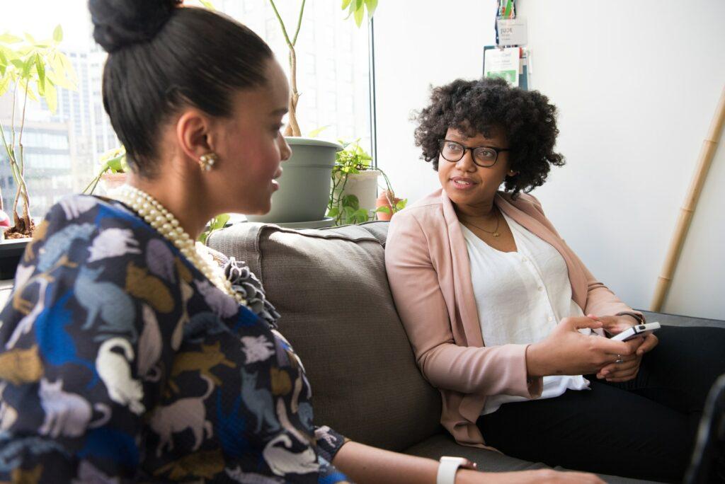 Two women discussing a loan
